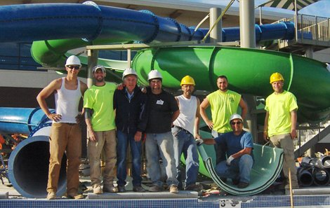 Commercial Pool Installation Crew in front of Water Slides at Cleveland Ohio Water Park