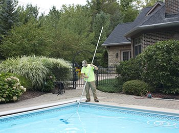 In Ground Pool being Cleaned by Cleveland Area Maintenance Technician